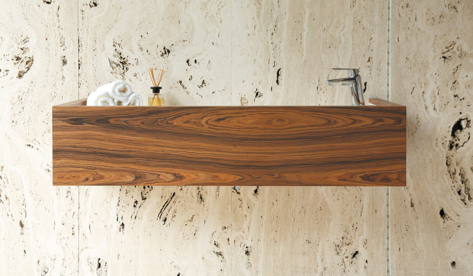 Washbasin in travertine marble and cabinet in palisander wood